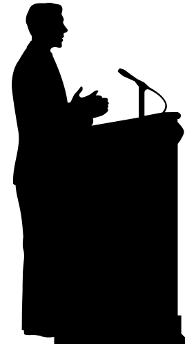 Black silhouette of a person at apodium speaking