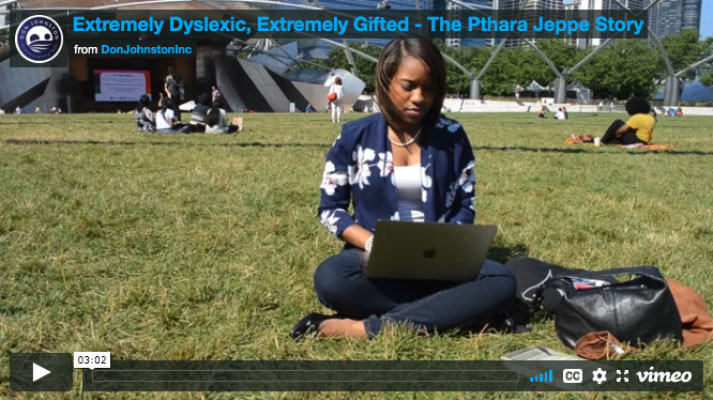 Pthara Jeppe sitting in the grassat a park working on a laptop