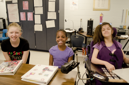 Three First Author students smile in the classroom