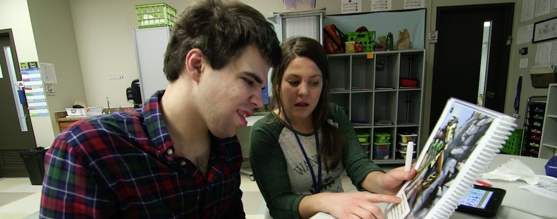 Teachers' Alliance member helps student with reading