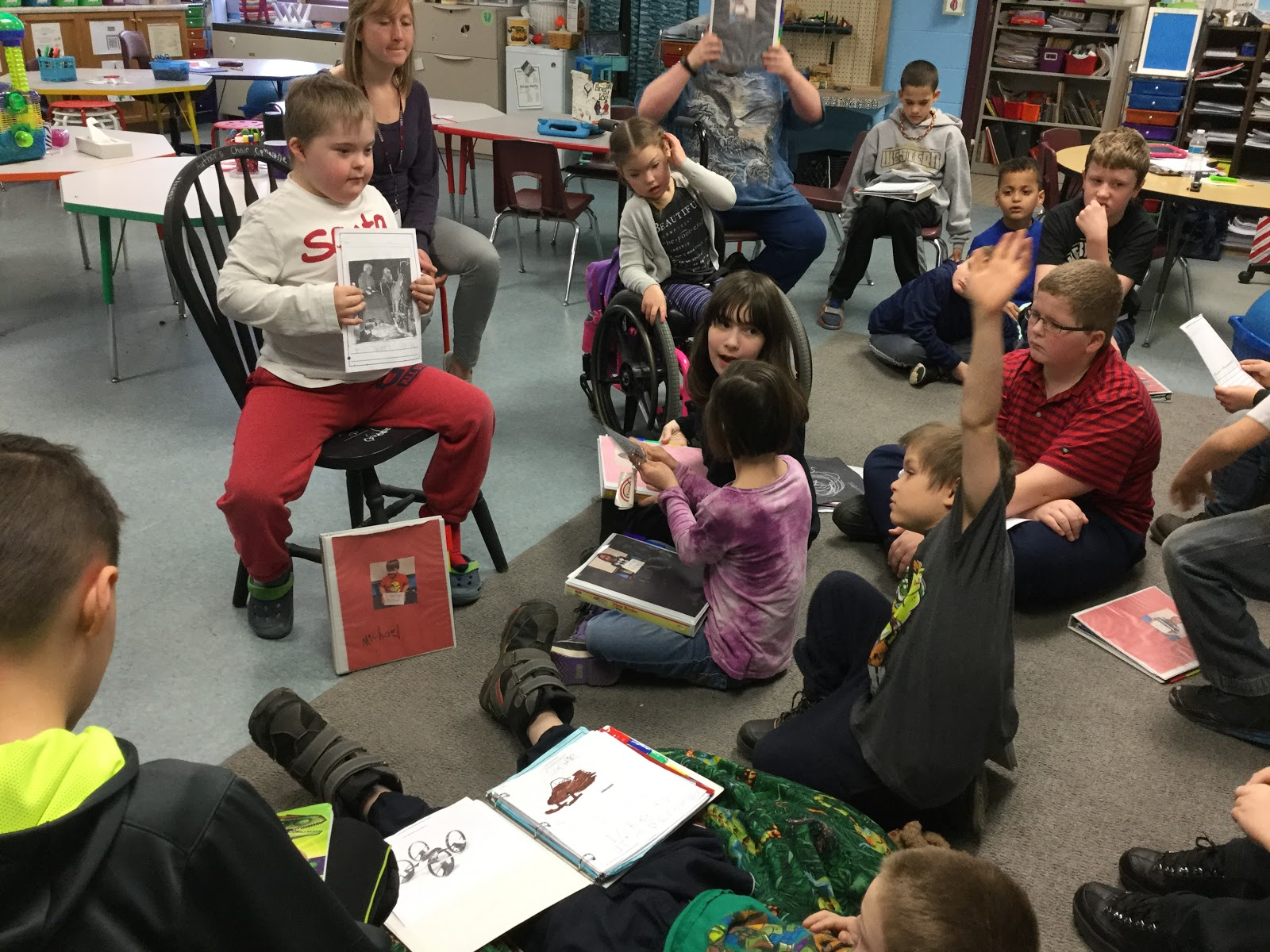 Boy in Authors Chair sharing with his class