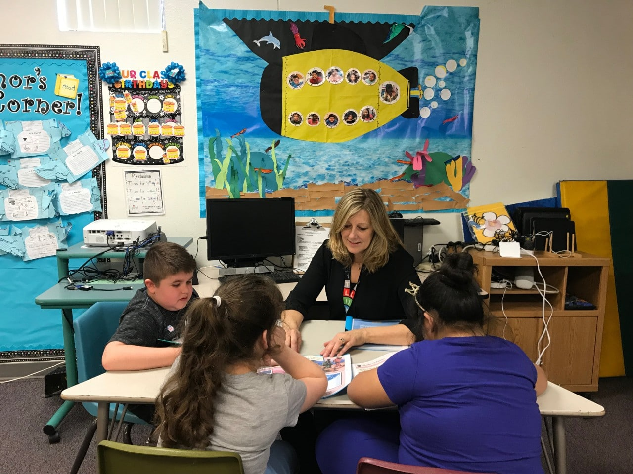Patti Hummel working with her students in the classroom