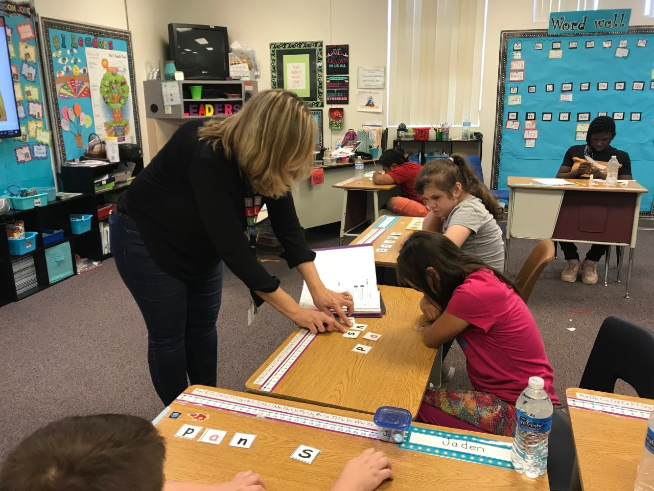 Patti Hummel working with a student in the classroom