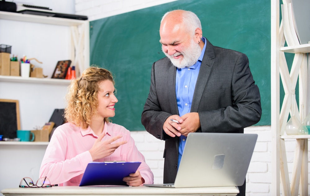 Teacher with principal smiling