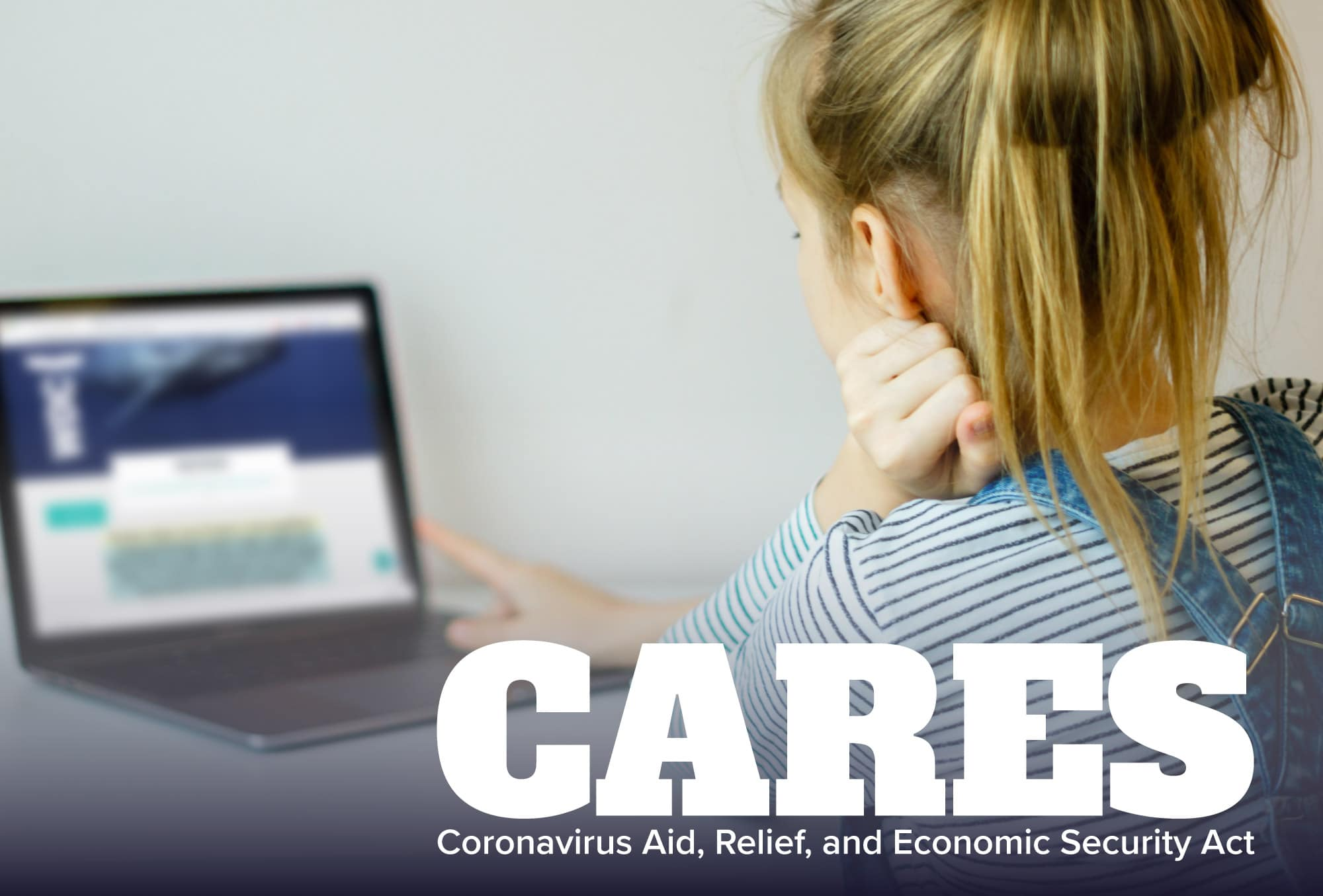 Student working on computer with CARES funding logo