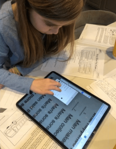 Student Olivia working on her tablet